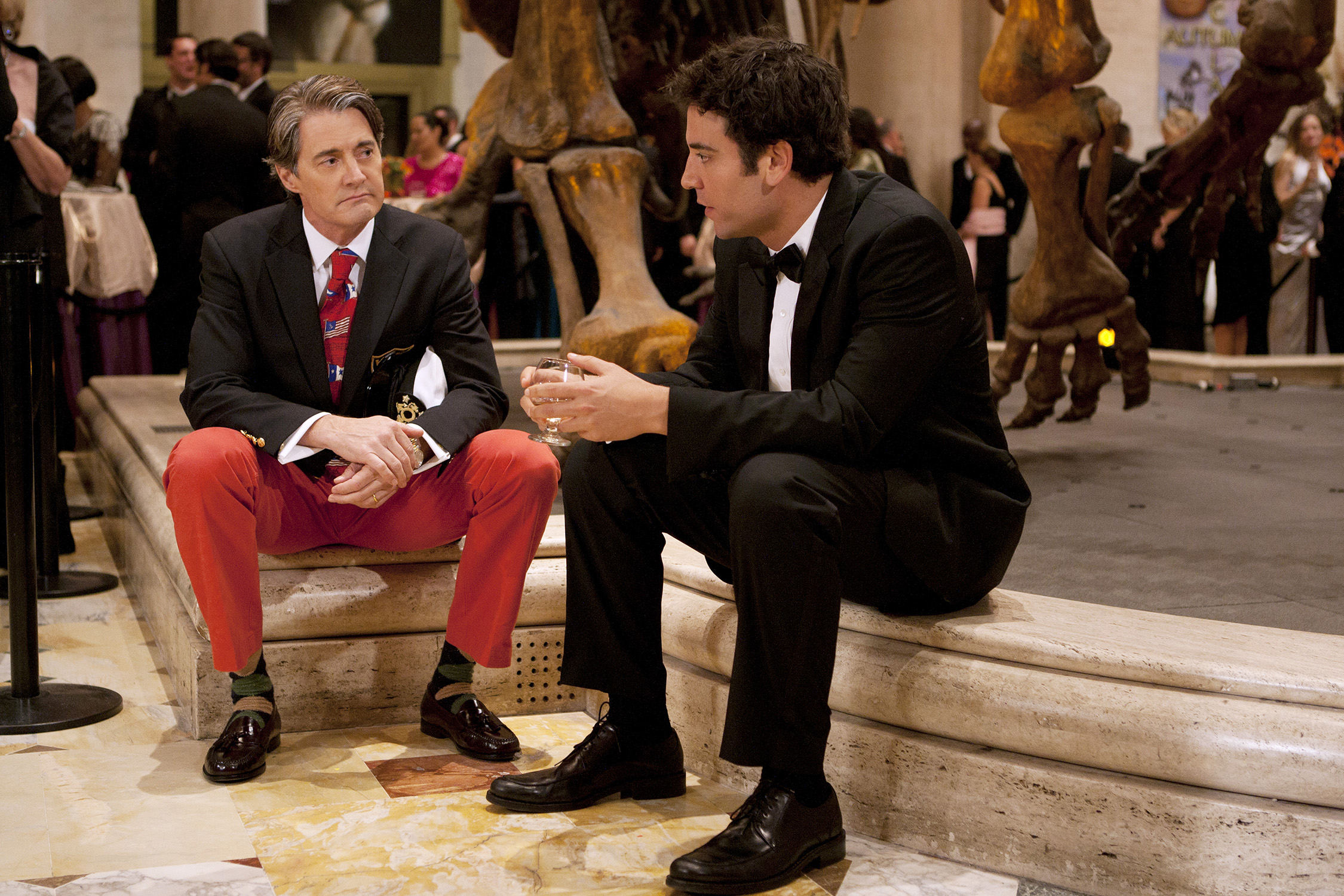 "Josh Radnor as Ted (right) meets Kyle MacLachlan as the Captain (left) at a Museum of Natural History fundraiser. ""Natural History,"" Season 6, Episode 8 of How I Met Your Mother. Photo: Matt Kennedy/FOX © FOX Television. All Rights Reserved."