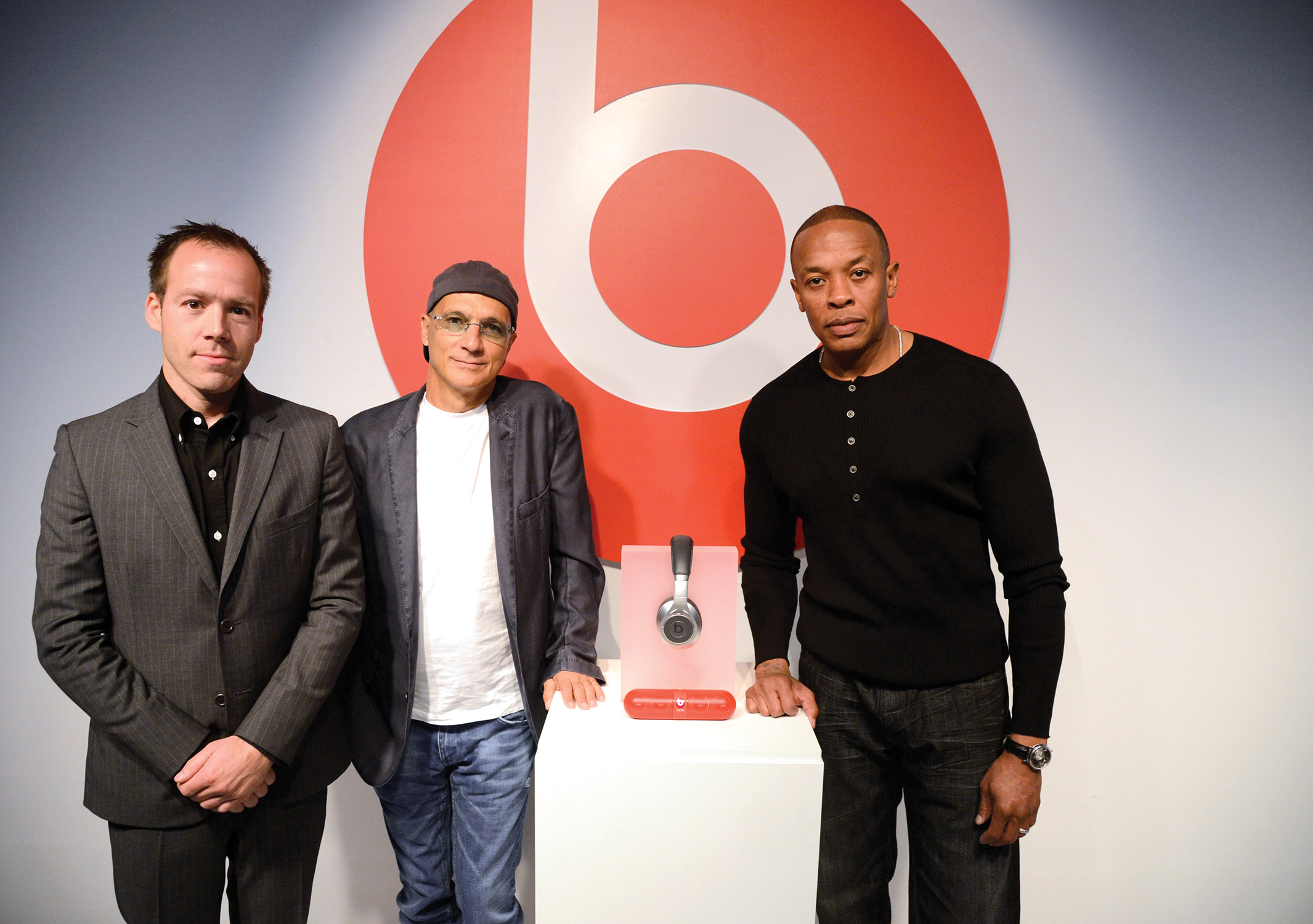 Company president Luke Wood '91 joins Beats Electronics co-founders Jimmy Iovine and Dr. Dre displaying their must-have headphones.