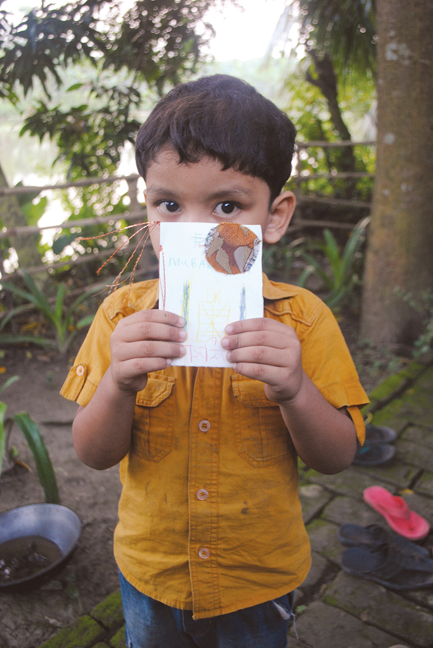 This little Bangladeshi boy's handmade card  will become part of Marvin D. Cabrera's Art in a Suitcase project. Cabrera will take the artwork back to students in New York City, who will in turn craft projects to send to their new friends in South Asia.