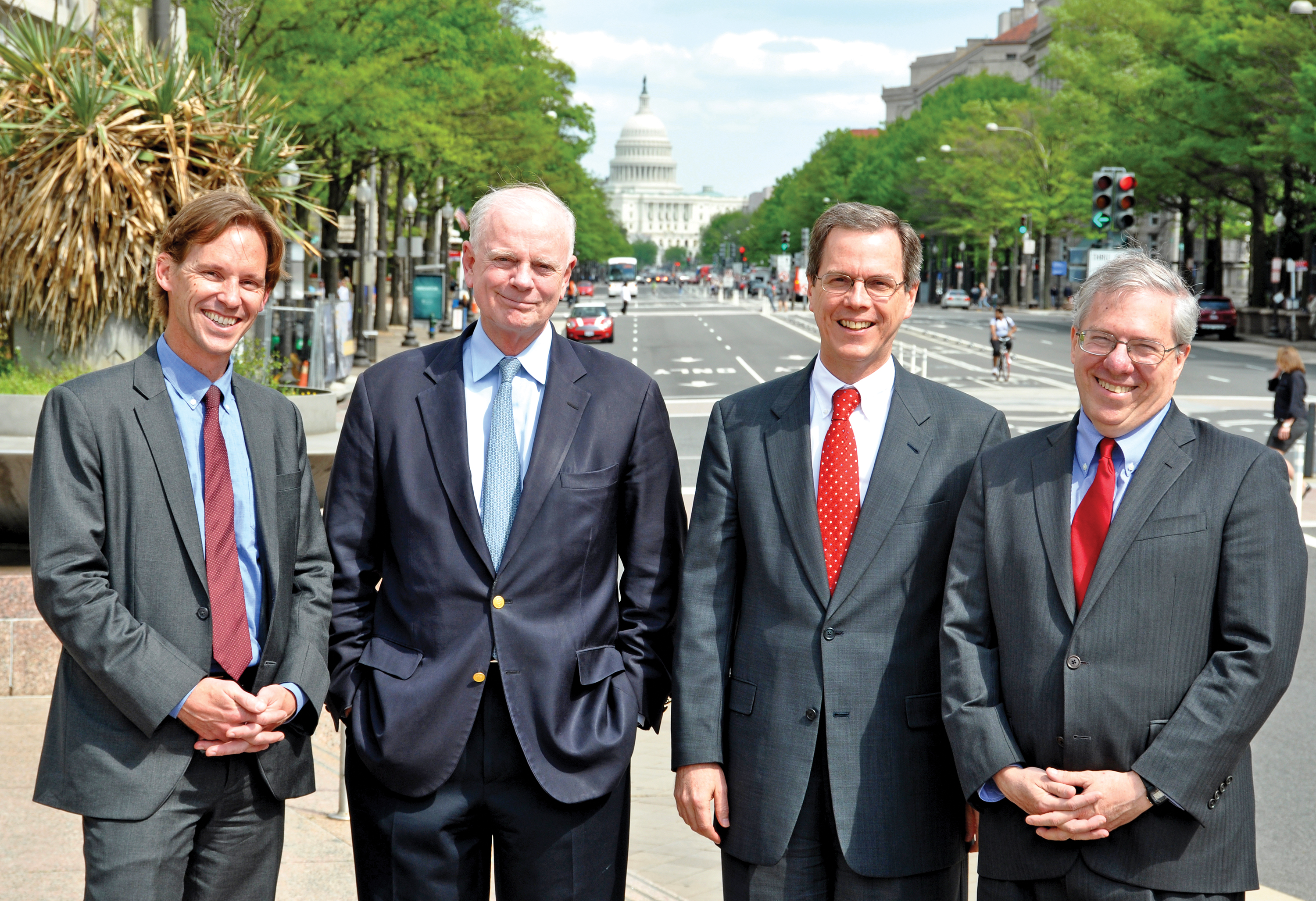 Four Wesleyan graduates collaborate on USAID's  crucial water projects, just down the avenue from the White House: John Pasch '93, Christian Holmes '68, Charles North '82, and Eric Postel '77.