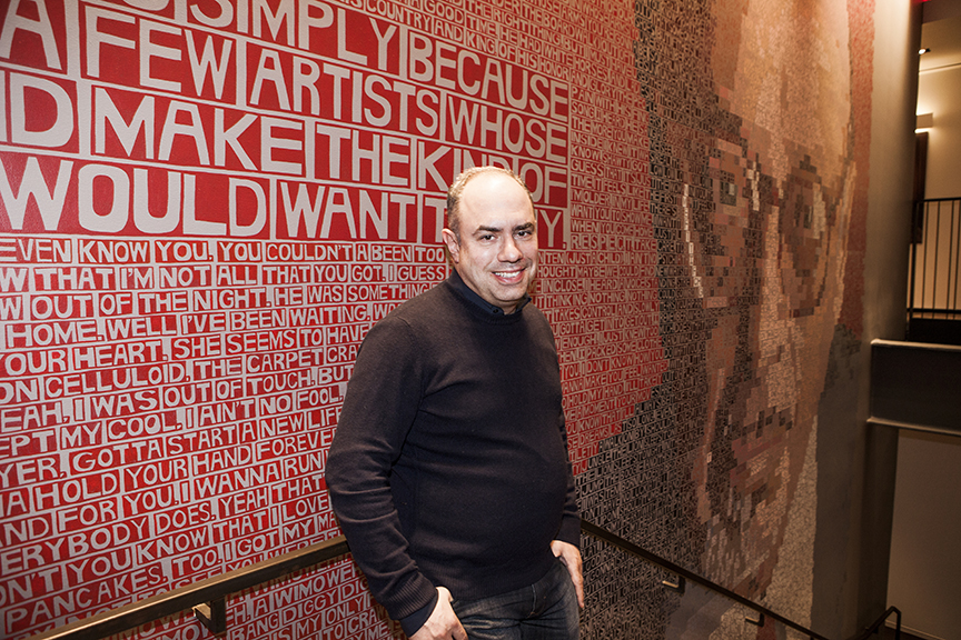 Pete Ganbarg in front of Ahmet Ertegun Mural
