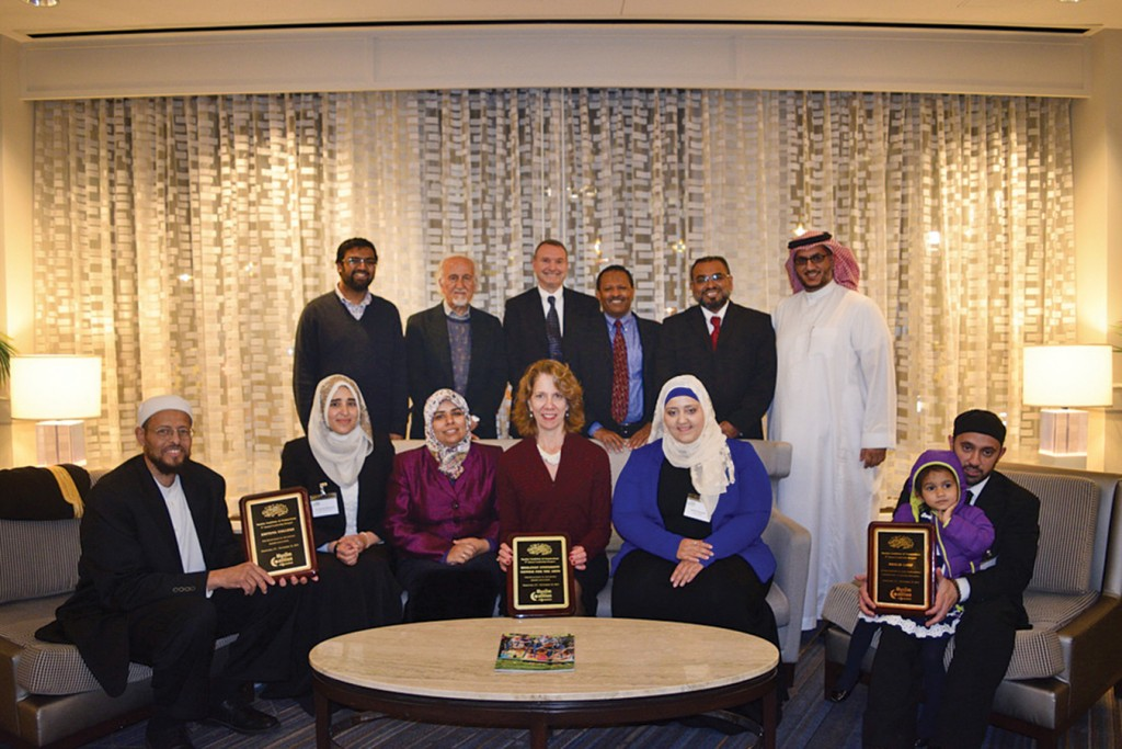 """The Muslim Coalition of Connecticut selected Wesleyan's Center for the Arts (CFA) as one of three honorees. Director of the CFA Pamela Tatge '84, MALS '10, P'16 (center) accepted on behalf of the university. Imam Zaid Shakir (left) from Zaytuna College and Imam Khalid Latif (right) from New York University were also selected as those """"bridging cultural gaps."""" Photo: Muslim Coalition of Connecticut."""