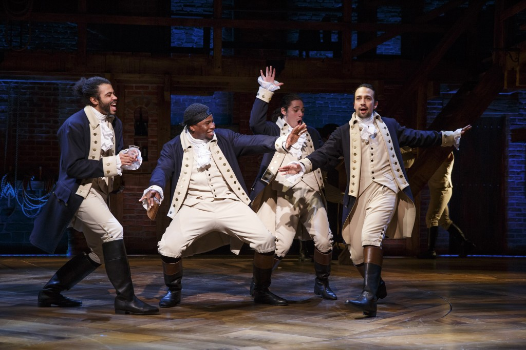 The historic characters in  Hamilton   wear period dress but their hip-hop singing and dance movements are rooted in the 21st century. From left, Daveed Diggs, Okieriete Onaodowan, Anthony Ramos, and Lin-Manuel Miranda in the title role. Photo: Joan Marcus.