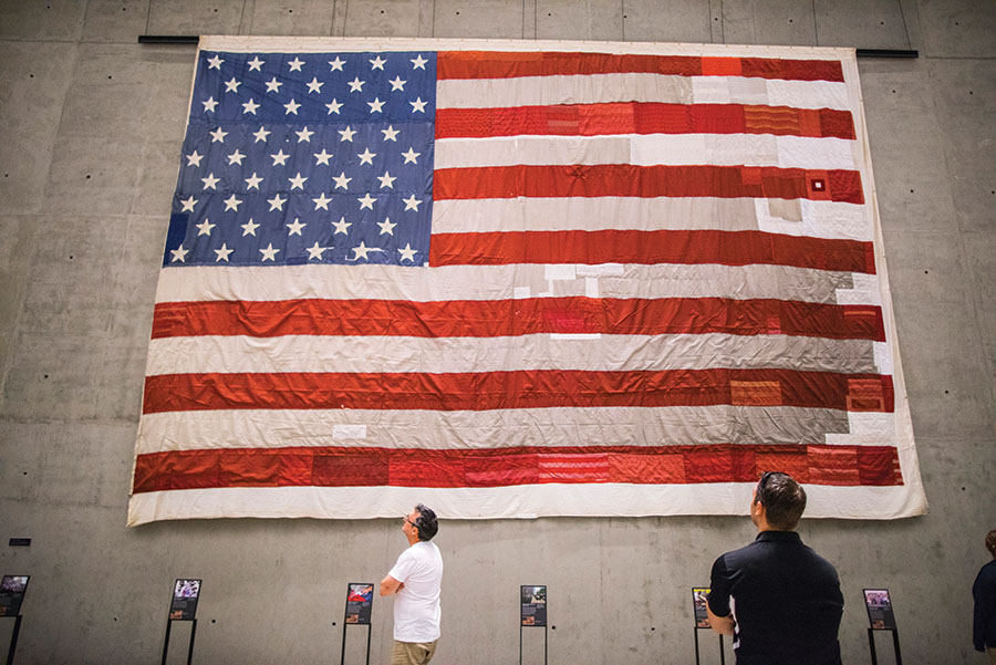 "4. The 30-foot-wide National 9/11 Flag originally hung on a building across from the WTC site. In 2008, the tattered flag began its cross-country journey with the New York Says Thank You Foundation, an organization dedicated to paying it forward by helping other communities touched by disaster. Using thread and patches from decommissioned American flags from all 50 states, including material from the flag on which Abraham Lincoln was laid after his assassination and threads from the flag that inspired Francis Scott Key to pen ""The Star-Spangled Banner,"" the National 9/11 Flag is a symbol of civic pride and the spirit of volunteerism. Photo: Jin Lee/911 Memorial."