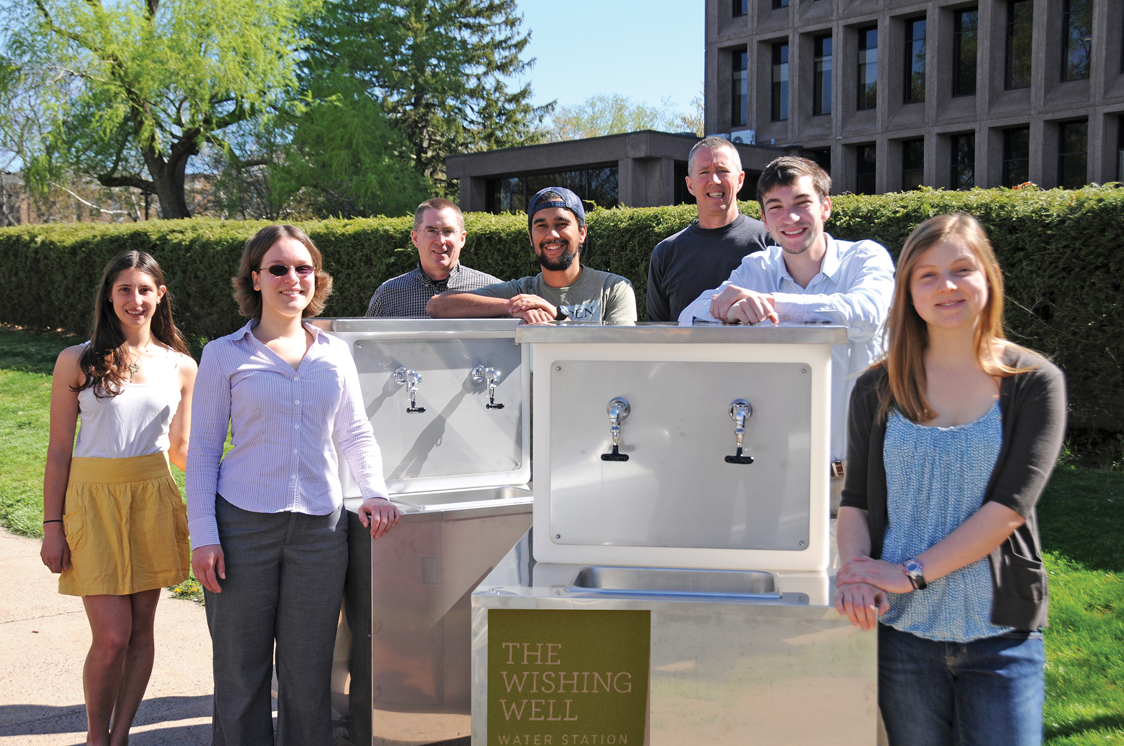 "From left, Nina Gerona '15; Jen Kleindienst, sustainability coordinator; Bruce Strickland, instrument maker specialist; Tavo True-Alcalá '15; Dave Strickland, instrument maker specialist; Brent Packer '15; and Madeleine O'Brien '16 present the student-designed ""Wishing Well."" Photo by Olivia Drake MALS '08."